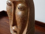 """Rosemary Exhibiting with """"Thunder in our Voices"""" Brazilian soapstone, black pearl stone 21"""" H x 14"""" L x 7"""" D"""